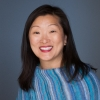 Grace Kim Headshot; Woman; Centered; Smiling; blue striped shawl